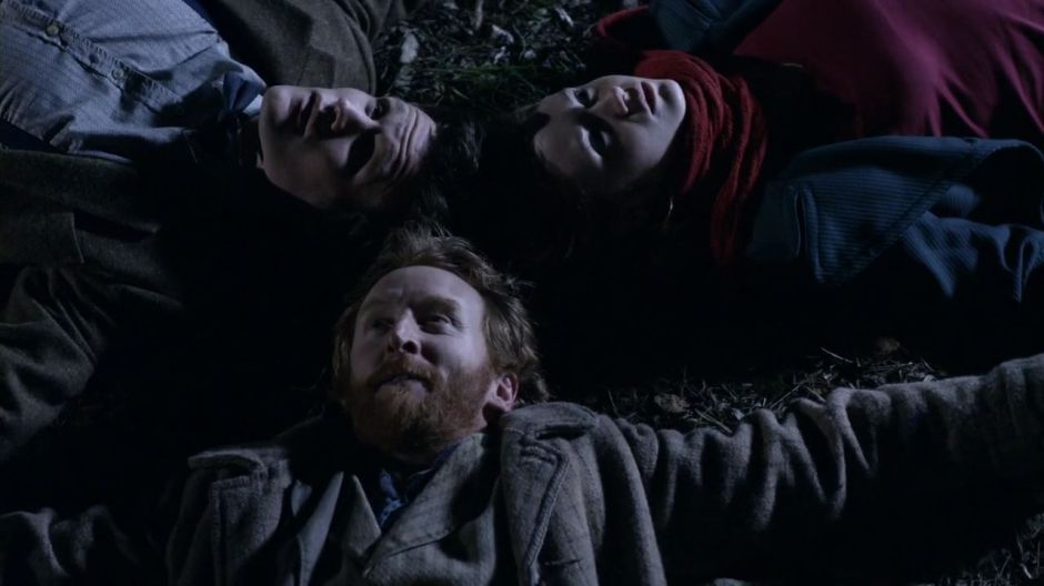 Vincent, Amy and the Doctor on a starry night.
