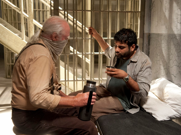 Hershel helps a sick Dr. Subramanian with a natural tea.