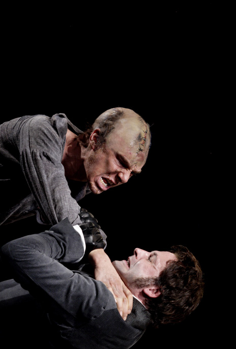 Johnny Lee Miller as Victor Frankenstein and Benedict Cumberbatch as the monster in Danny Boyle's stage adaptation of Frankenstein.