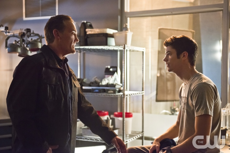 """The Flash -- """"Gorilla Warfare"""" -- Image FLA207B_0019b.jpg -- Pictured (L-R): John Wesley Shipp as Henry Allen and Grant Gustin as Barry Allen -- Photo: Cate Cameron/The CW -- © 2015 The CW Network, LLC. All rights reserved."""