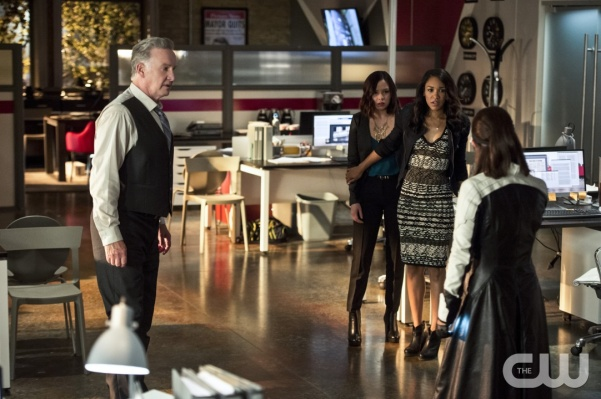 "The Flash -- ""The Darkness and the Light"" -- Image FLA205B_0090b.jpg -- Pictured (L-R): Tom Butler as Eric Larkin, Malese Jow as Linda Park and Candice Patton as Iris West -- Photo: Cate Cameron/The CW -- © 2015 The CW Network, LLC. All rights reserved."