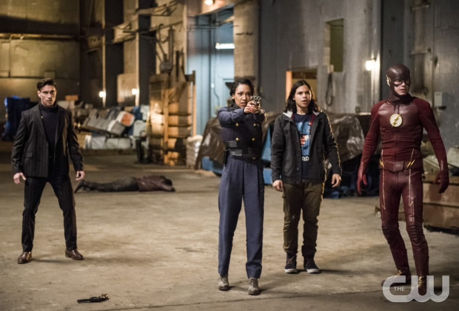 """The Flash -- """"Welcome to Earth-2"""" -- Image FLA213a_0110b -- Pictured (L-R): Michael Rowe as Floyd Lawton, Candice Patton as Earth 2 Iris West, Carlos Valdes as Cisco Ramon, and Grant Gustin as The Flash -- Photo: Diyah Pera/The CW -- © 2016 The CW Network, LLC. All rights reserved."""